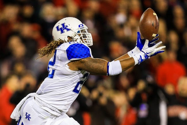 Nov 23, 2013; Athens, GA, USA; Kentucky Wildcats linebacker Khalid Henderson (22) intercepts a tipped pass in the first half against the Georgia Bulldogs at Sanford Stadium. Mandatory Credit: Daniel Shirey-USA TODAY Sports
