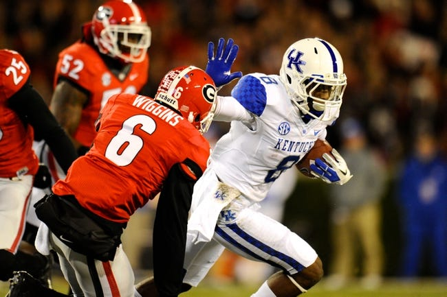 Nov 23, 2013; Athens, GA, USA; Kentucky Wildcats wide receiver Javess Blue (8) tries to prevent a tackle by Georgia Bulldogs cornerback Shaq Wiggins (6) during the second quarter at Sanford Stadium. Mandatory Credit: Dale Zanine-USA TODAY Sports