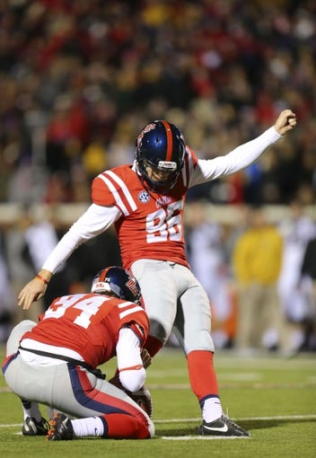 Nov 23, 2013; Oxford, MS, USA; Mississippi Rebels kicker Andrew Ritter (96) kicks a field goal during the game against the Missouri Tigers at Vaught-Hemingway Stadium. Mandatory Credit: Spruce Derden-USA TODAY Sports