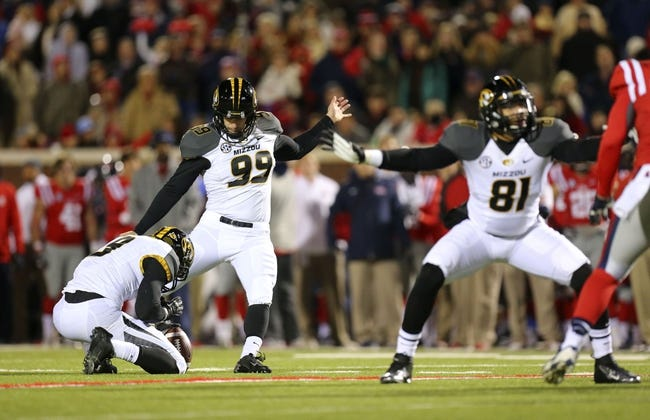 Nov 23, 2013; Oxford, MS, USA; Missouri Tigers kicker Andrew Baggett (99) kicks a field goal during the game against the Mississippi Rebels at Vaught-Hemingway Stadium. Mandatory Credit: Spruce Derden-USA TODAY Sports