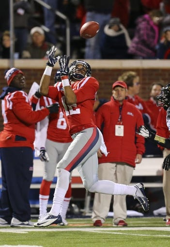 Nov 23, 2013; Oxford, MS, USA; Mississippi Rebels wide receiver Donte Moncrief (12) brings in a reception during the game against the Missouri Tigers at Vaught-Hemingway Stadium. Mandatory Credit: Spruce Derden-USA TODAY Sports