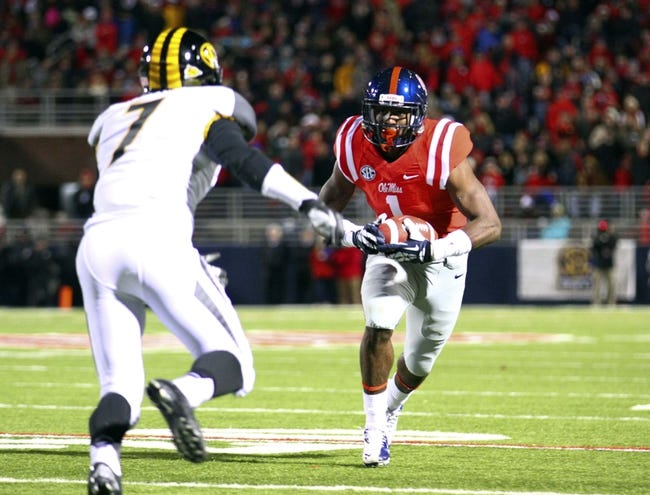 Nov 23, 2013; Oxford, MS, USA; Mississippi Rebels wide receiver Laquon Treadwell (1) advances the ball against Missouri Tigers defensive back Randy Ponder (7) during the game at Vaught-Hemingway Stadium. Mandatory Credit: Spruce Derden-USA TODAY Sports