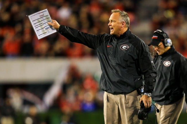 Nov 23, 2013; Athens, GA, USA; Georgia Bulldogs head coach Mark Richt reacts to a call in the second half against the Kentucky Wildcats at Sanford Stadium. The Georgia Bulldogs won 59-17. Mandatory Credit: Daniel Shirey-USA TODAY Sports