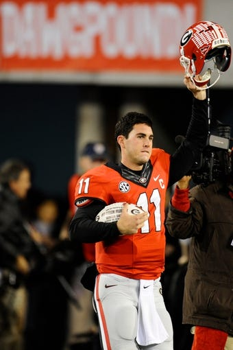 Nov 23, 2013; Athens, GA, USA; Georgia Bulldogs quarterback Aaron Murray (11) enters the field for the last time on senior night against the Kentucky Wildcats at Sanford Stadium. Georgia defeated Kentucky 59-17. Mandatory Credit: Dale Zanine-USA TODAY Sports