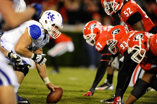 Nov 23, 2013; Athens, GA, USA; Kentucky Wildcats center Jon Toth (72) lines up against Georgia Bulldogs nose tackle Chris Mayes (93) during the second half at Sanford Stadium. Georgia defeated Kentucky 59-17. Mandatory Credit: Dale Zanine-USA TODAY Sports