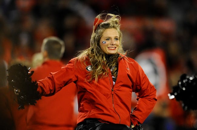 Nov 23, 2013; Athens, GA, USA; A Georgia Bulldogs cheerleader shown on the field during the game against the Kentucky Wildcats at Sanford Stadium. Georgia defeated Kentucky 59-17. Mandatory Credit: Dale Zanine-USA TODAY Sports