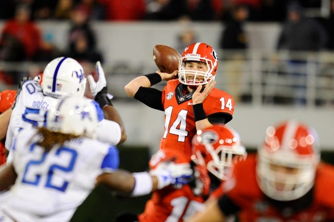 Nov 23, 2013; Athens, GA, USA; Georgia Bulldogs quarterback Hutson Mason (14) passes against the Kentucky Wildcats during the second half at Sanford Stadium. Georgia defeated Kentucky 59-17. Mandatory Credit: Dale Zanine-USA TODAY Sports
