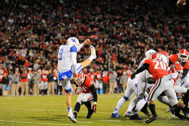 Nov 23, 2013; Athens, GA, USA; Georgia Bulldogs safety Connor Norman (11) partially blocks a punt by Kentucky Wildcats punter Landon Foster (9) during the second half at Sanford Stadium. Georgia defeated Kentucky 59-17. Mandatory Credit: Dale Zanine-USA TODAY Sports