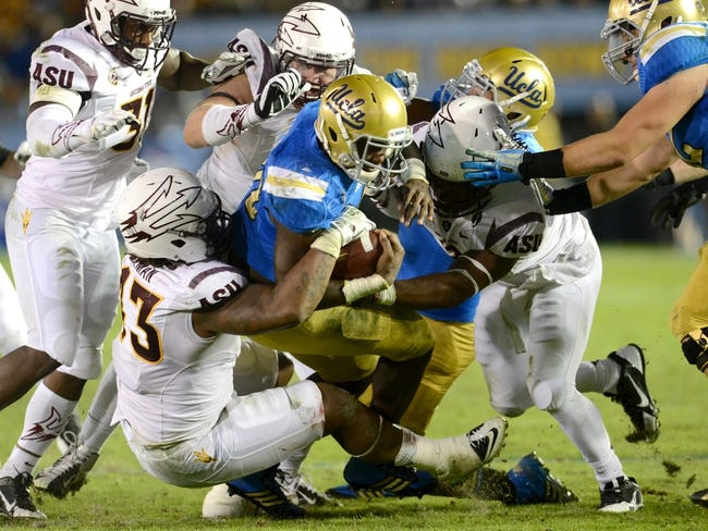 Nov 23, 2013; Pasadena, CA, USA;      UCLA Bruins linebacker Myles Jack (30) is stopped by the Arizona State Sun Devils defense after a 3-yard gain in the second half at the Rose Bowl. Arizona State Sun Devils won 38-33. Mandatory Credit: Jayne Kamin-Oncea-USA TODAY Sports