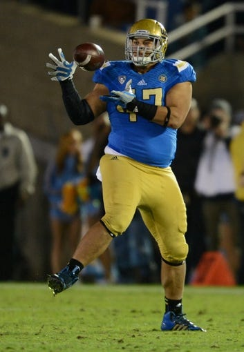Nov 23, 2013; Pasadena, CA, USA;      UCLA Bruins defensive end Eddie Vanderdoes (47) hands on to a pass in the second half of the game against the Arizona State Sun Devils at the Rose Bowl. Arizona State Sun Devils won 38-33. Mandatory Credit: Jayne Kamin-Oncea-USA TODAY Sports