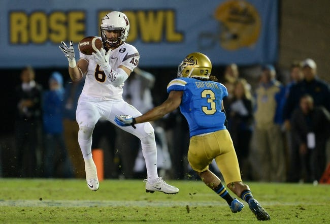 Nov 23, 2013; Pasadena, CA, USA;      UCLA Bruins safety Randall Goforth (3) breaks up a pass for Arizona State Sun Devils running back D.J. Foster (8) for a 17-yard loss in the second half at the Rose Bowl. Arizona State Sun Devils won 38-33. Mandatory Credit: Jayne Kamin-Oncea-USA TODAY Sports