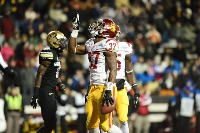 Nov 23, 2013; Boulder, CO, USA; Southern California Trojans running back Javorius Allen (37) reacts to his touchdown in the second quarter against the Colorado Buffaloes  at Folsom Field. Mandatory Credit: Ron Chenoy-USA TODAY Sports