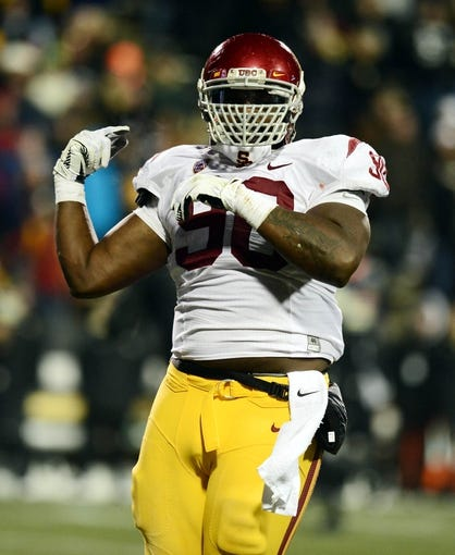Nov 23, 2013; Boulder, CO, USA; Southern California Trojans defensive end George Uko (90) reacts to his fumble recovery in the second quarter against the Colorado Buffaloes at Folsom Field. Mandatory Credit: Ron Chenoy-USA TODAY Sports