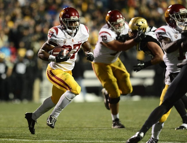Nov 23, 2013; Boulder, CO, USA; Southern California Trojans running back Javorius Allen (37) rushes in the second quarter against the Colorado Buffaloes at Folsom Field. Mandatory Credit: Ron Chenoy-USA TODAY Sports