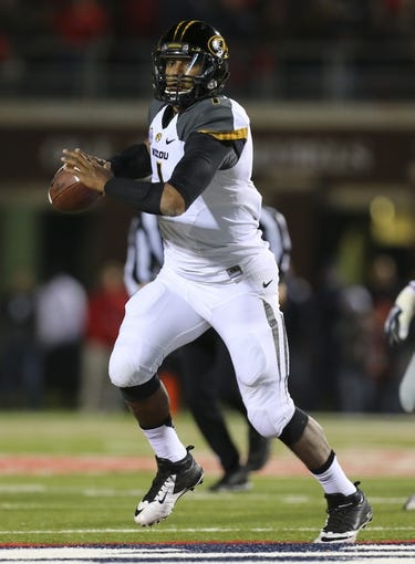 Nov 23, 2013; Oxford, MS, USA; Missouri Tigers quarterback James Franklin (1) passes the ball during the game against the Mississippi Rebels at Vaught-Hemingway Stadium. Missouri Tigers defeat the Mississippi Rebels 24-10.  Mandatory Credit: Spruce Derden-USA TODAY Sports
