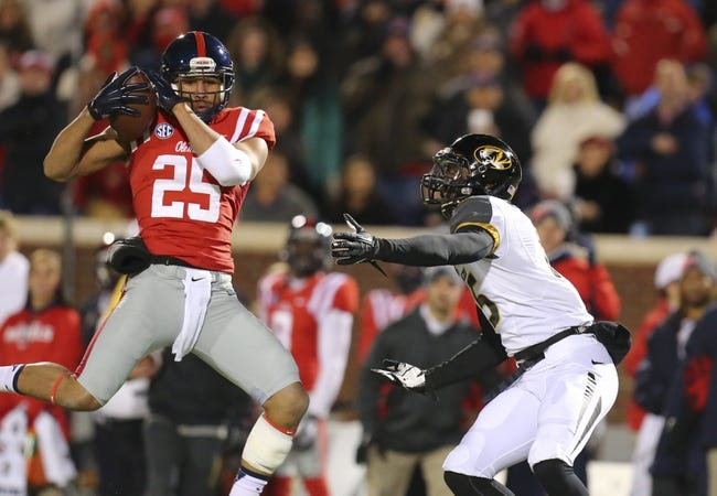 Nov 23, 2013; Oxford, MS, USA; Mississippi Rebels defensive back Cody Prewitt (25) intercepts the ball over Missouri Tigers wide receiver Dorial Green-Beckham (15) during the game at Vaught-Hemingway Stadium. Missouri Tigers defeat the Mississippi Rebels 24-10.  Mandatory Credit: Spruce Derden-USA TODAY Sports