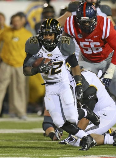 Nov 23, 2013; Oxford, MS, USA; Missouri Tigers running back Russell Hansbrough (32) advances the ball during the game against the Mississippi Rebels at Vaught-Hemingway Stadium. Missouri Tigers defeat the Mississippi Rebels 24-10.  Mandatory Credit: Spruce Derden-USA TODAY Sports