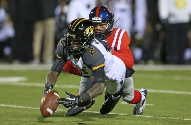 Nov 23, 2013; Oxford, MS, USA; Missouri Tigers wide receiver L'Damian Washington (2) reaches out for a pass while guarded by Mississippi Rebels defensive back Derrick Jones (19) during the game at Vaught-Hemingway Stadium. Missouri Tigers defeat the Mississippi Rebels 24-10.  Mandatory Credit: Spruce Derden-USA TODAY Sports