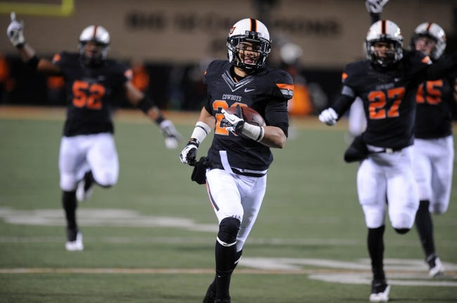 Nov 23, 2013; Stillwater, OK, USA;  Oklahoma State Cowboys cornerback Tyler Patmon (26) runs for a touchdown after a fumble recovery against the Baylor Bears at Boone Pickens Stadium. Mandatory Credit: Mark D. Smith-USA TODAY Sports