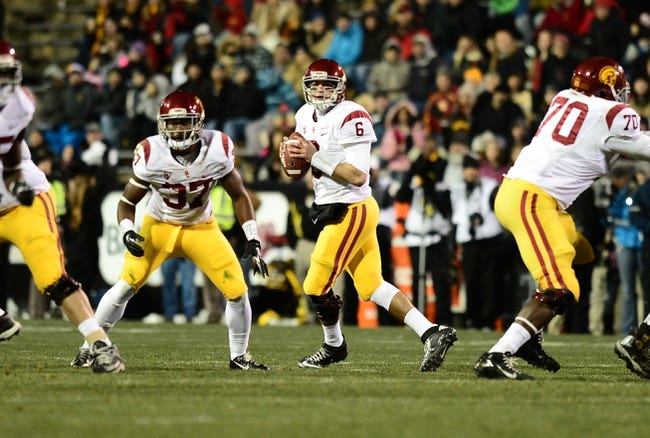 Nov 23, 2013; Boulder, CO, USA; Southern California Trojans quarterback Cody Kessler (6) prepares to pass as running back Javorius Allen (37) and offensive tackle Aundrey Walker (70) pass block in the first quarter against the Colorado Buffaloes against the Colorado Buffaloes at Folsom Field. Mandatory Credit: Ron Chenoy-USA TODAY Sports