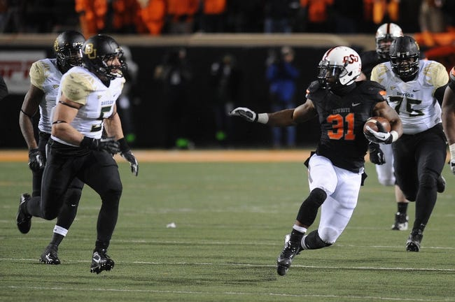 Nov 23, 2013; Stillwater, OK, USA;  Oklahoma State Cowboys running back Jeremy Smith (31) runs the ball against Baylor Bears linebacker Eddie Lackey (5) at Boone Pickens Stadium. Mandatory Credit: Mark D. Smith-USA TODAY Sports