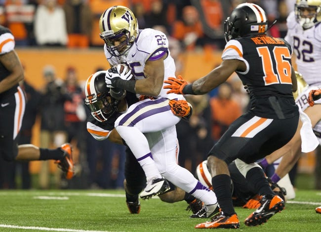 Nov 23, 2013; Corvallis, OR, USA; Washington Huskies running back Bishop Sankey (25) heads upfield against Oregon State Beavers in the first half at Reser Stadium. Mandatory Credit: Jaime Valdez-USA TODAY Sports