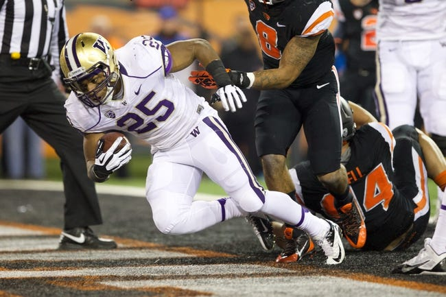 Nov 23, 2013; Corvallis, OR, USA; Washington Huskies running back Bishop Sankey (25) scores a touchdown against Oregon State Beavers in the first half at Reser Stadium. Mandatory Credit: Jaime Valdez-USA TODAY Sports
