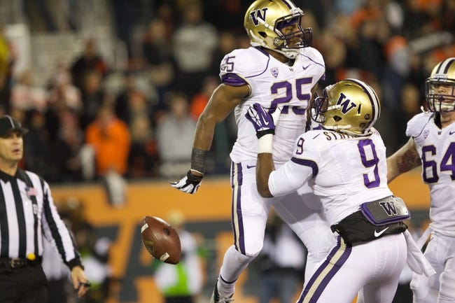 Nov 23, 2013; Corvallis, OR, USA; Washington Huskies running back Bishop Sankey (25) celebrates with teammate  Huskies' wide receiver Damore'ea Stringfellow (9)  after scoring a touchdown against Oregon State Beavers in the first half at Reser Stadium. Mandatory Credit: Jaime Valdez-USA TODAY Sports