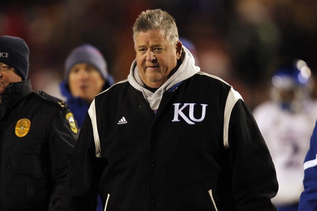 Nov 23, 2013; Ames, IA, USA; Kansas Jayhawks head coach Charlie Weis leaves the field at half time against the Iowa State Cyclones at Jack Trice Stadium. Iowa State won 34-0. Mandatory Credit: Bruce Thorson-USA TODAY Sports