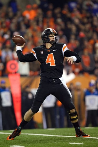 Nov 23, 2013; Corvallis, OR, USA; Oregon State Beavers quarterback Sean Mannion (4) throws a pass against the Washington Huskies in the first half at Reser Stadium. Mandatory Credit: Jaime Valdez-USA TODAY Sports