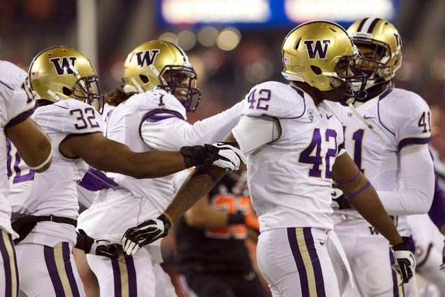 Nov 23, 2013; Corvallis, OR, USA; Washington Huskies congratulate  linebacker Cory Littleton (42) after a tackle against the Oregon State Beavers during a kickoff return in the first half at Reser Stadium. Mandatory Credit: Jaime Valdez-USA TODAY Sports