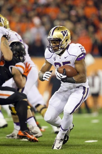 Nov 23, 2013; Corvallis, OR, USA; Washington Huskies running back Bishop Sankey (25) heads up field against Oregon State Beavers in the first half at Reser Stadium. Mandatory Credit: Jaime Valdez-USA TODAY Sports
