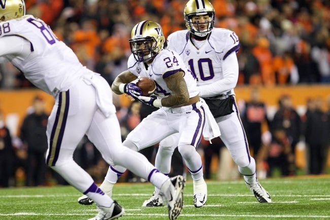 Nov 23, 2013; Corvallis, OR, USA; Washington Huskies running back Jesse Callier (24) takes a handoff from quarterback Cyler Miles (10) against Oregon State Beavers in the first half at Reser Stadium. Mandatory Credit: Jaime Valdez-USA TODAY Sports