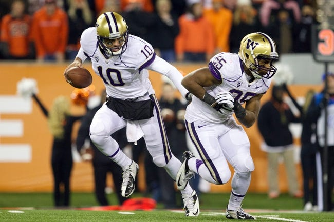 Nov 23, 2013; Corvallis, OR, USA; Washington Huskies quarterback Cyler Miles (10) fakes a hand off running back Bishop Sankey (25)  against Oregon State Beavers at Reser Stadium. Mandatory Credit: Jaime Valdez-USA TODAY Sports