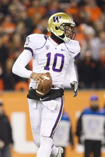 Nov 23, 2013; Corvallis, OR, USA; Washington Huskies quarterback Cyler Miles (10) looks for a open receiver against Oregon State Beavers at Reser Stadium. Mandatory Credit: Jaime Valdez-USA TODAY Sports