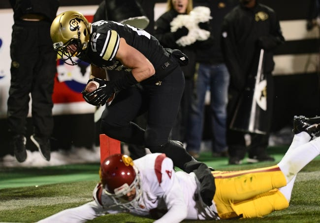 Nov 23, 2013; Boulder, CO, USA; Colorado Buffaloes wide receiver Nelson Spruce (22) scores a touchdown over the defense of Southern California Trojans cornerback Torin Harris (4) in the fourth quarter at Folsom Field. The Trojans defeated the Buffaloes 47-29. Mandatory Credit: Ron Chenoy-USA TODAY Sports