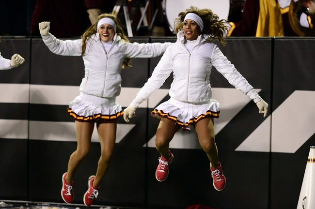 Nov 23, 2013; Boulder, CO, USA; Southern California Trojans cheerleaders perform during the game against the Colorado Buffaloes at Folsom Field. Mandatory Credit: Ron Chenoy-USA TODAY Sports