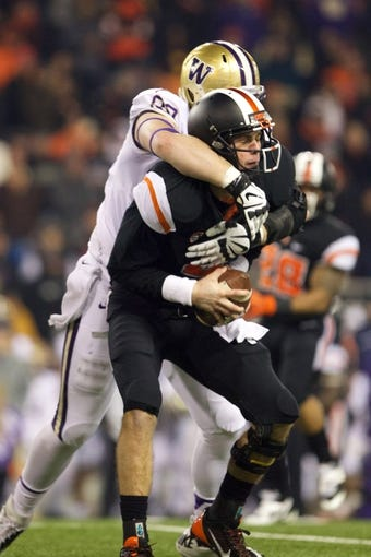 Nov 23, 2013; Corvallis, OR, USA; Washington Huskies defensive end Evan Hudson (80) sacks Oregon State Beavers quarterback Sean Mannion (4) in the second half at Reser Stadium. Mandatory Credit: Jaime Valdez-USA TODAY Sports