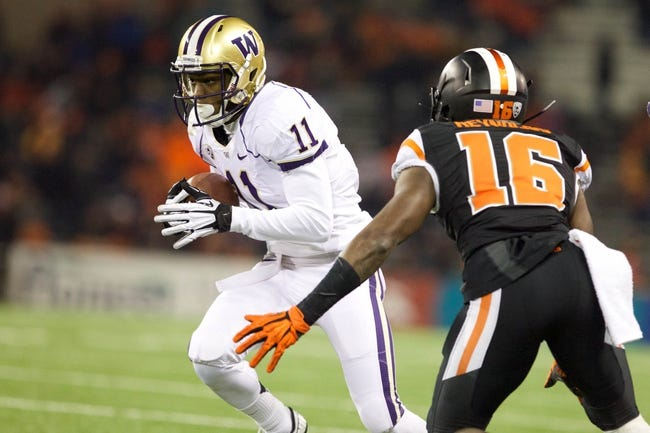 Nov 23, 2013; Corvallis, OR, USA; Washington Huskies defensive tackle Elijah Qualls (11) runs past Oregon State Beavers cornerback Rashaad Reynolds (16) in the second half at Reser Stadium. Mandatory Credit: Jaime Valdez-USA TODAY Sports