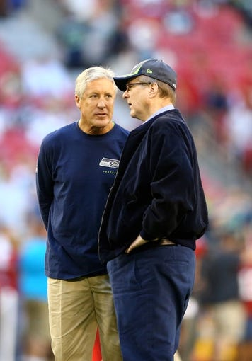 Oct 17, 2013; Phoenix, AZ, USA; Seattle Seahawks head coach Pete Carroll (left) with team owner Paul Allen against the Arizona Cardinals at University of Phoenix Stadium. Mandatory Credit: Mark J. Rebilas-USA TODAY Sports