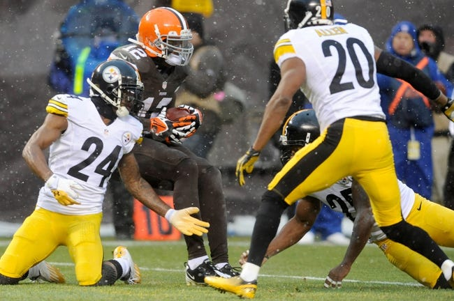 Nov 24, 2013; Cleveland, OH, USA; Cleveland Browns wide receiver Josh Gordon (12) catches a pass as Pittsburgh Steelers cornerback Ike Taylor (24) and Pittsburgh Steelers strong safety Will Allen (20) defend during the fourth quarter at FirstEnergy Stadium. The Steelers beat the Browns 27-11. Mandatory Credit: Ken Blaze-USA TODAY Sports