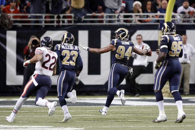 Nov 24, 2013; St. Louis, MO, USA;  St. Louis Rams defensive end Robert Quinn (94) scores a touchdown during the fourth quarter against the Chicago Bears at the Edward Jones Dome. Mandatory Credit: Scott Kane-USA TODAY Sports