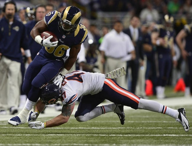 Nov 24, 2013; St. Louis, MO, USA; St. Louis Rams running back Benny Cunningham (36) is tackled by Chicago Bears free safety Chris Conte (47) during the second half at the Edward Jones Dome. St. Louis defeated Chicago 42-21. Mandatory Credit: Jeff Curry-USA TODAY Sports