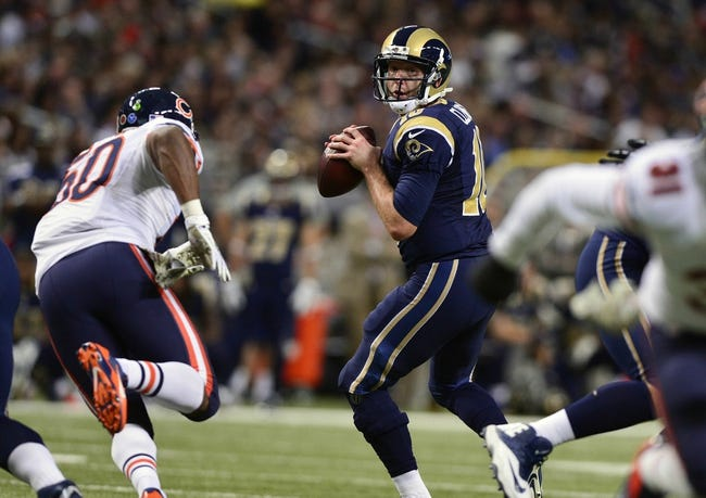 Nov 24, 2013; St. Louis, MO, USA; St. Louis Rams quarterback Kellen Clemens (10) throws against the Chicago Bears during the second half at the Edward Jones Dome. St. Louis defeated Chicago 42-21. Mandatory Credit: Jeff Curry-USA TODAY Sports