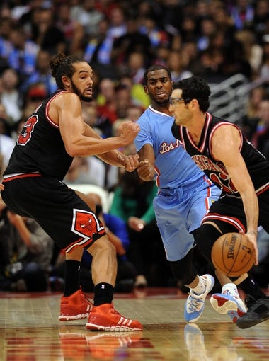 Nov 24, 2013; Los Angeles, CA, USA;  Chicago Bulls center Joakim Noah (13) screens Los Angeles Clippers point guard Chris Paul (3) as Chicago Bulls shooting guard Kirk Hinrich (12) takes the ball to the basket in the first half of the game at Staples Center. Clippers won 121-82. Mandatory Credit: Jayne Kamin-Oncea-USA TODAY Sports