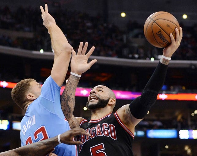 Nov 24, 2013; Los Angeles, CA, USA;  Los Angeles Clippers power forward Blake Griffin (32) guards Chicago Bulls power forward Carlos Boozer (5) in the second half of the game at Staples Center. Clippers won 121-82. Mandatory Credit: Jayne Kamin-Oncea-USA TODAY Sports