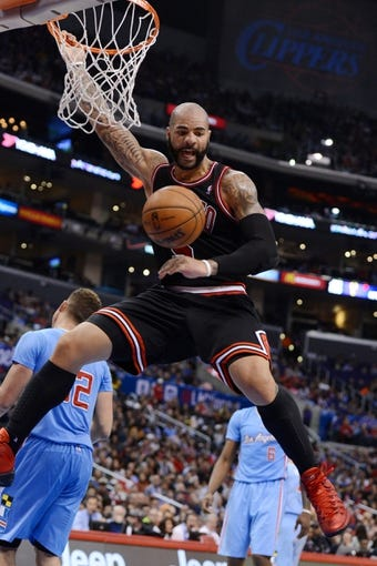 Nov 24, 2013; Los Angeles, CA, USA;  Chicago Bulls power forward Carlos Boozer (5) dunks in the second half the game against the Los Angeles Clippers at Staples Center. Clippers won 121-82. Mandatory Credit: Jayne Kamin-Oncea-USA TODAY Sports