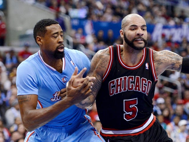 Nov 24, 2013; Los Angeles, CA, USA;  Los Angeles Clippers center DeAndre Jordan (6) and Chicago Bulls power forward Carlos Boozer (5) battle under the basket in the second half of the game at Staples Center. Clippers won 121-82. Mandatory Credit: Jayne Kamin-Oncea-USA TODAY Sports