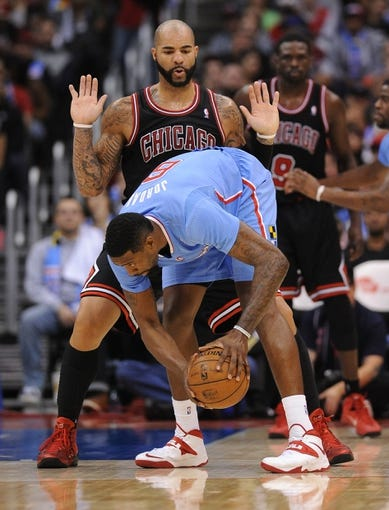 Nov 24, 2013; Los Angeles, CA, USA;  Chicago Bulls power forward Carlos Boozer (5) guards Los Angeles Clippers center DeAndre Jordan (6) in the second half the game at Staples Center. Clippers won 121-82. Mandatory Credit: Jayne Kamin-Oncea-USA TODAY Sports