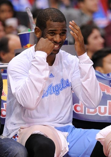 Nov 24, 2013; Los Angeles, CA, USA;  Los Angeles Clippers point guard Chris Paul (3) on the bench gesturing to boxer Floyd Mayweather, Jr (not pictured) who was sitting court side in the fourth quarter of the game against the Chicago Bulls at the Staples Center. Clippers won 121-82. Mandatory Credit: Jayne Kamin-Oncea-USA TODAY Sports